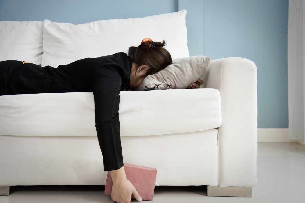 Exhausted woman on couch - Do you lack energy?