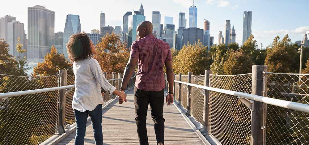 What types of cannabis are legal in NY? Couple walking on bridge in NY