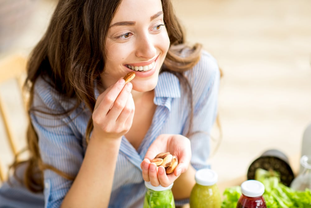 Foods that enhance CBD woman enjoys nuts