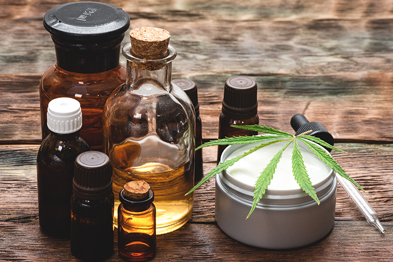 a collection of CBD products with a marijuana leaf